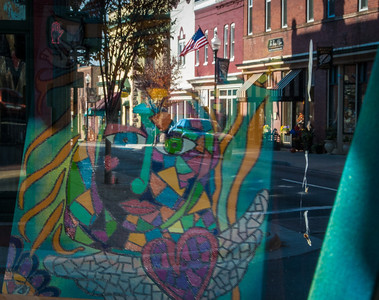 Blessing from Above reflection of Karen Sielski picture in ArtBeat gallery window  in Manassas, VA